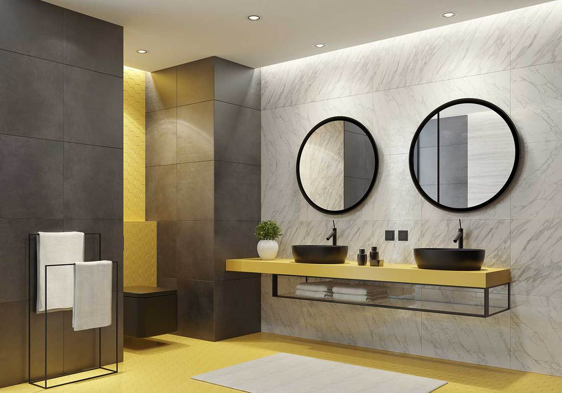 Luxurious bathroom with yellow honeycomb ceramic tiles and large grey marble ceramic tiles and glass shelf