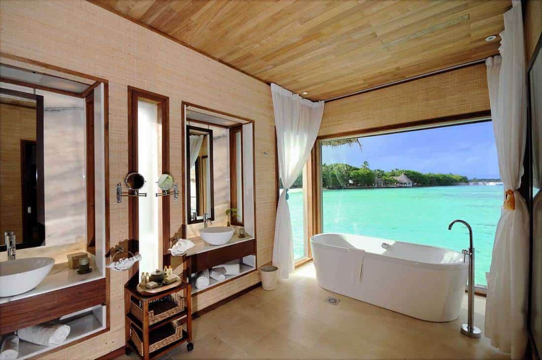 Luxury beach villa bathroom with sea view