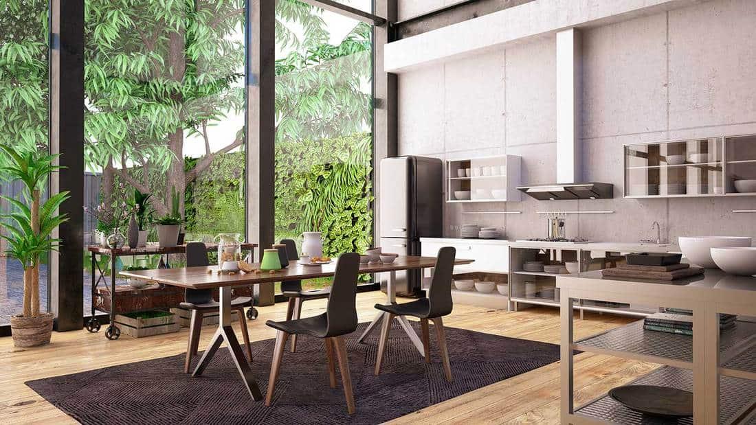 Luxury industrial loft kitchen with garden view