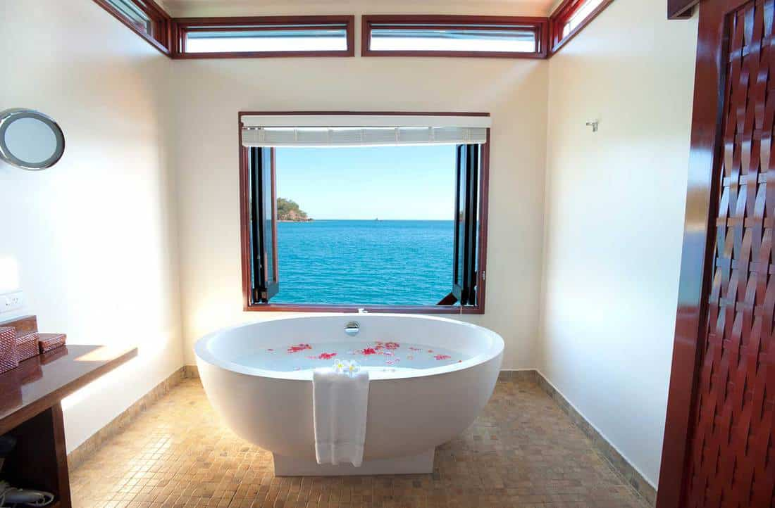 Luxury resort bathroom with ocean view