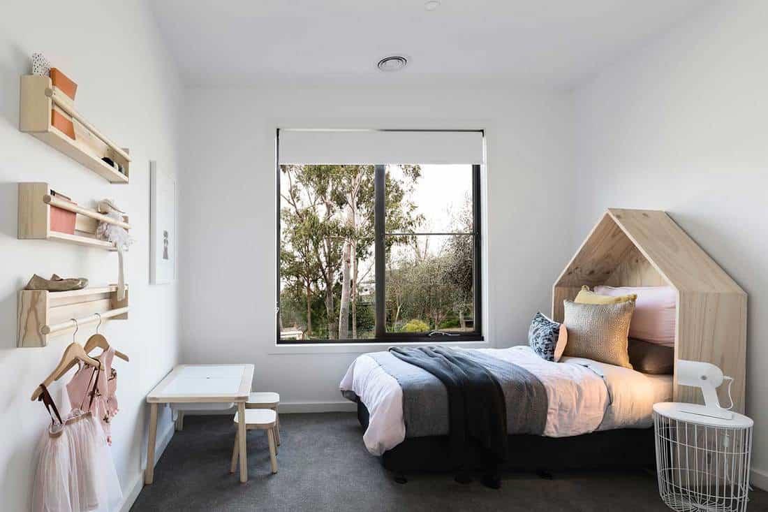 Minimalist girls bedroom with wooden interior