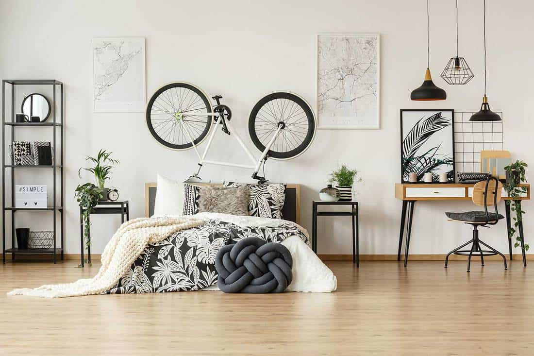 Modern bedroom with black and white interior and industrial style lighting