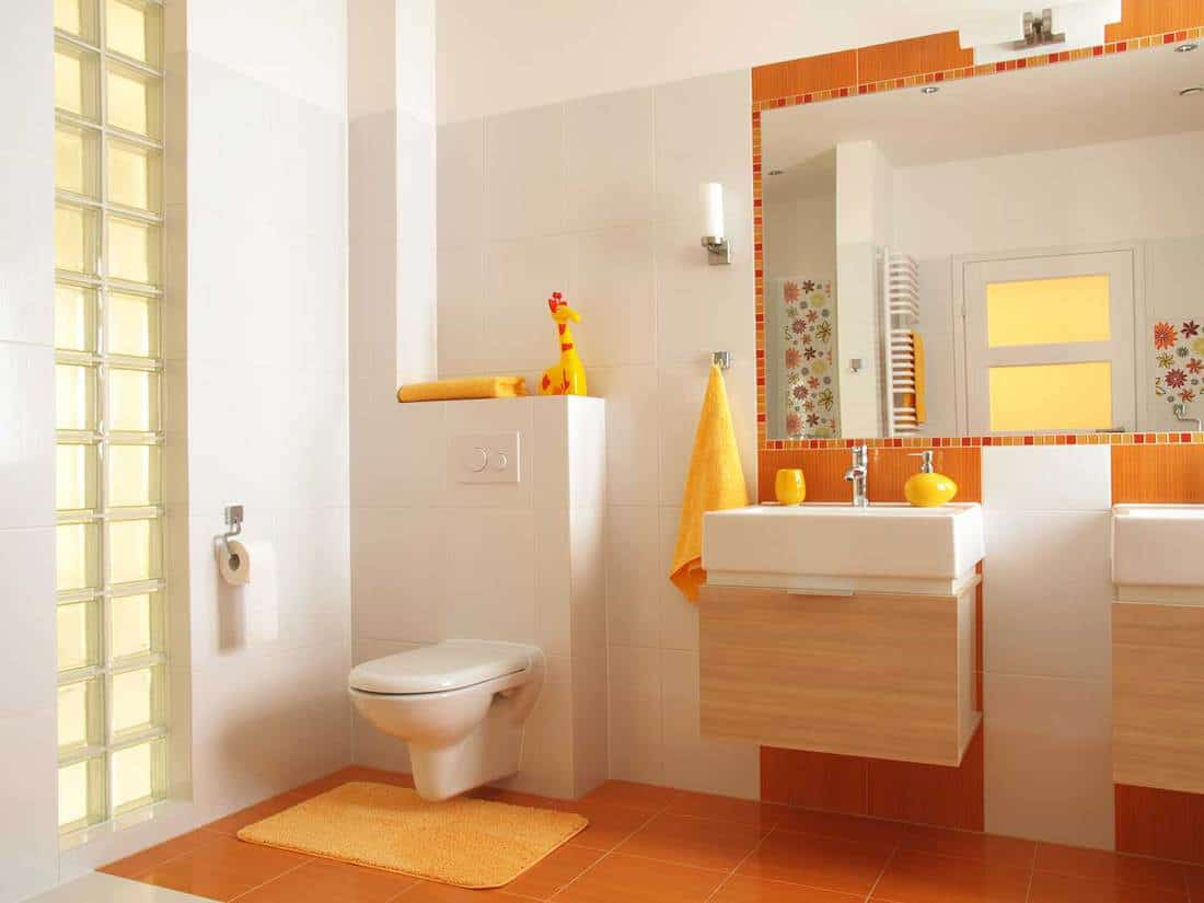 Modern home bathroom with yellow towel and rug