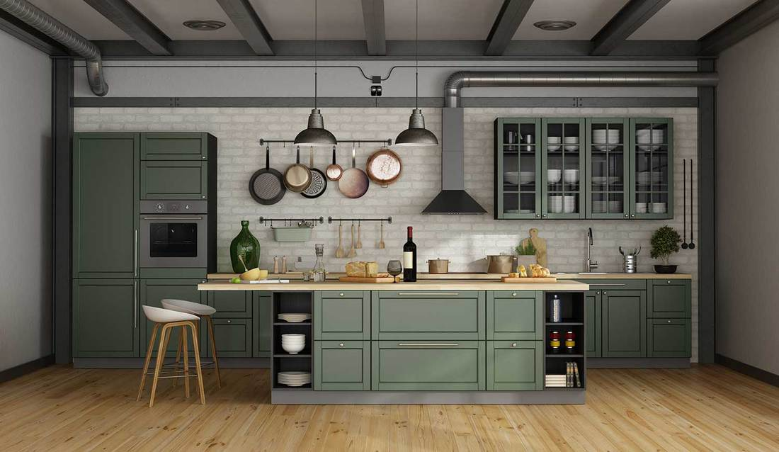 Modern industrial style green kitchen interior with island in a loft apartment