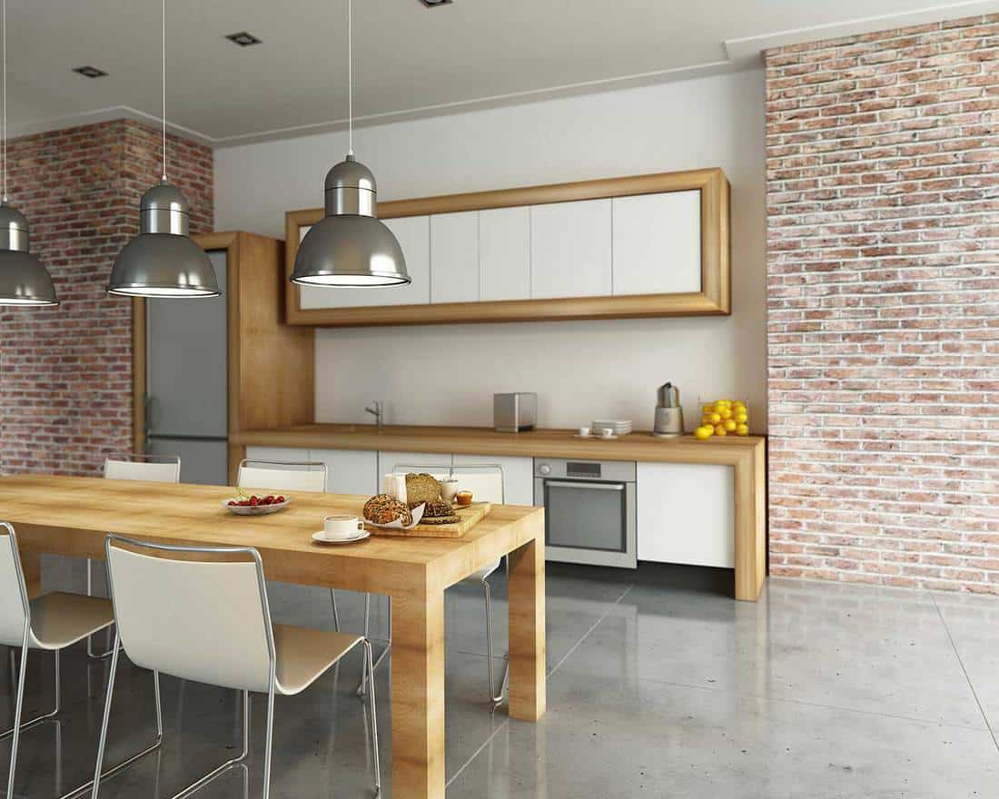 Modern industrial style kitchen with brick walls