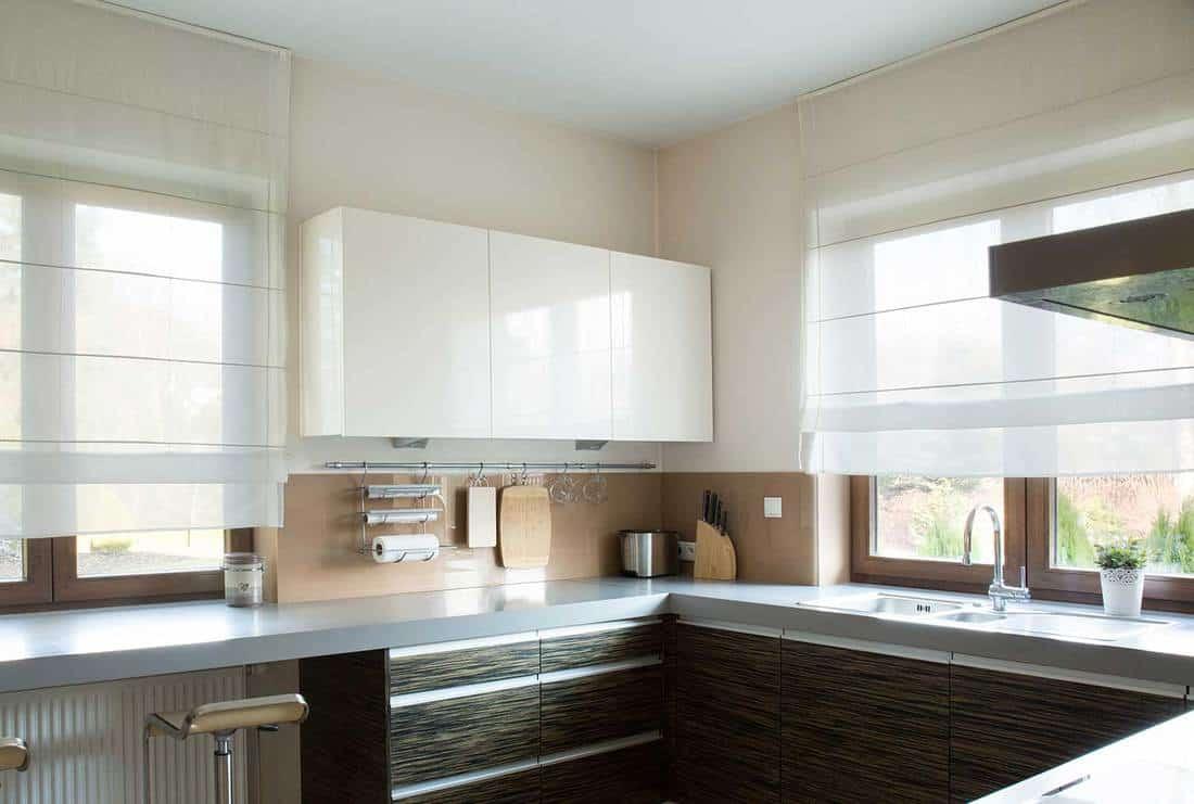 Modern kitchen with white curtain