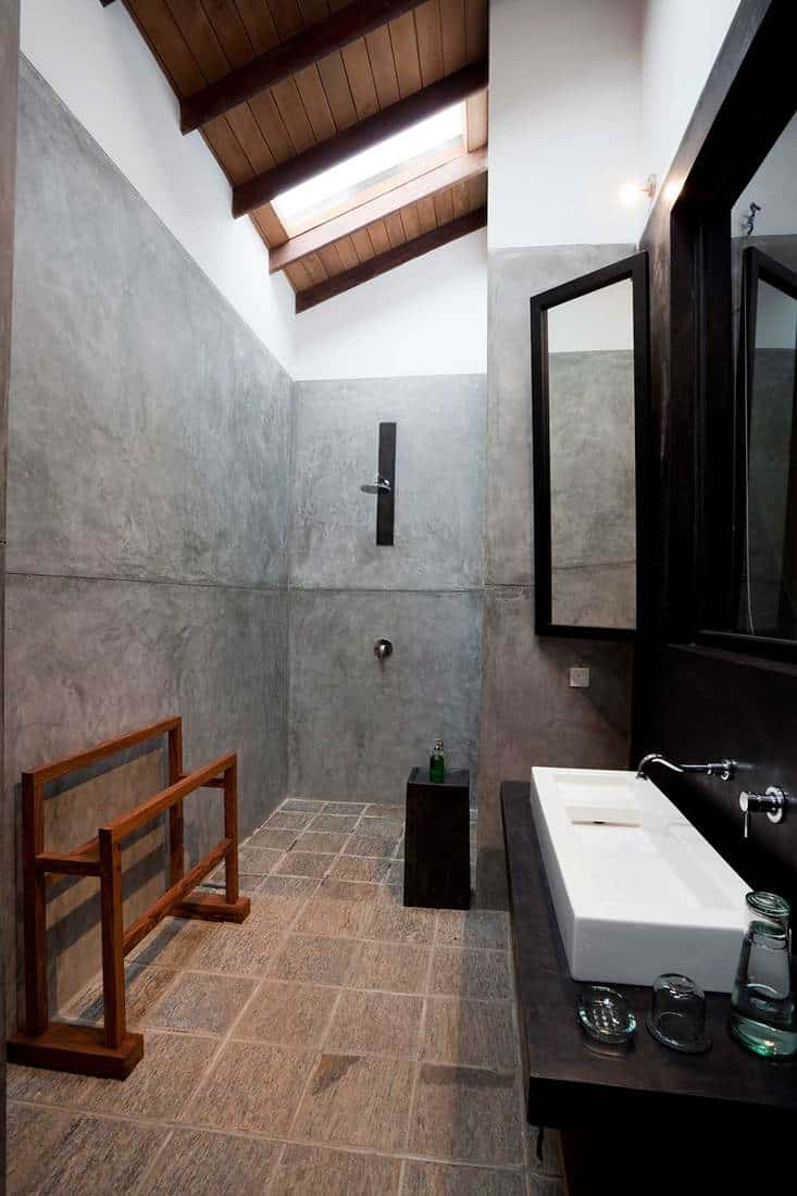 Modern loft bathroom with concrete wall