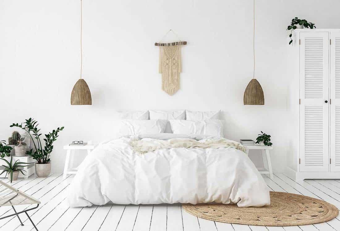 Scandi-boho style bedroom with wooden floor