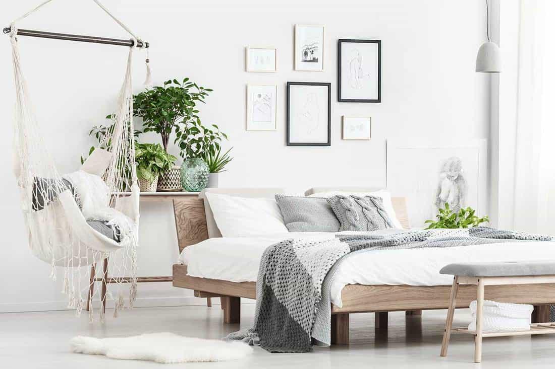 Scandinavian bedroom interior with artistic painting