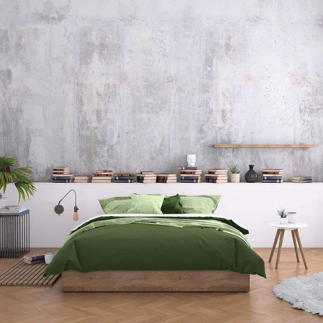 Scandinavian minimalist bedroom with green bed and parquet flooring