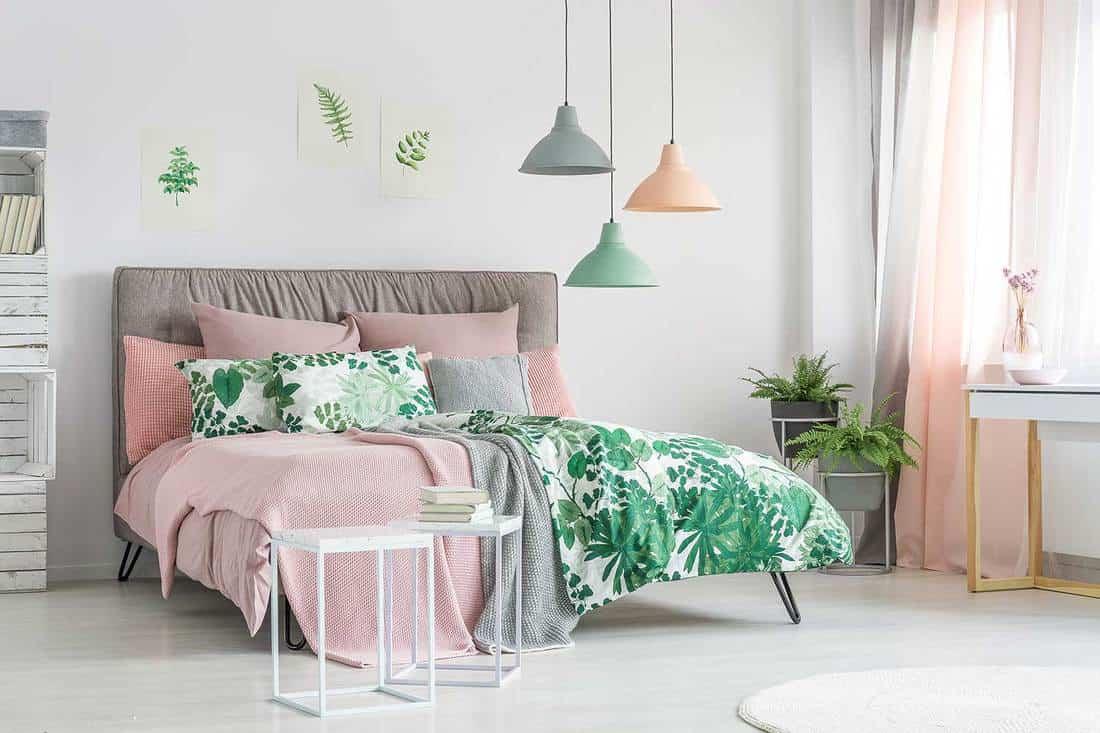 Stylish feminine minimalist bedroom interior