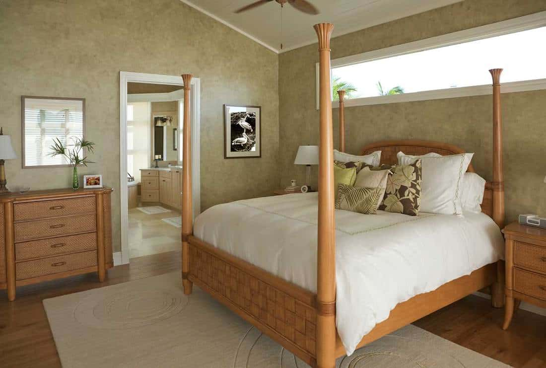 Tropical themed bedroom in a house by the beach