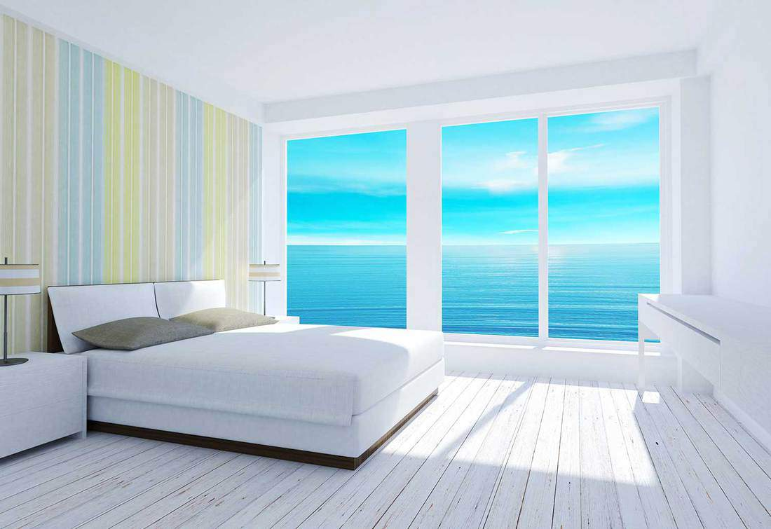 White modern bedroom interior with sea view