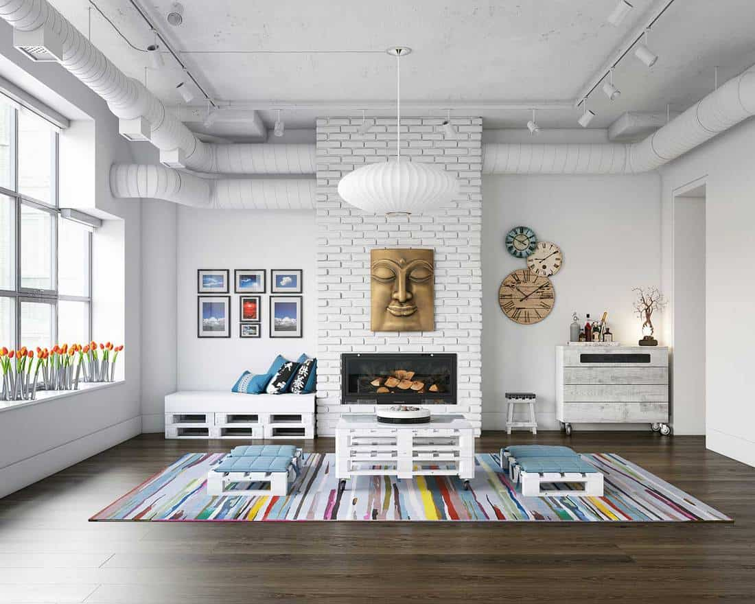 White themed industrial loft living room interior with wooden furniture