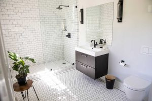 A bright and airy modern bathroom with tiled brick walls
