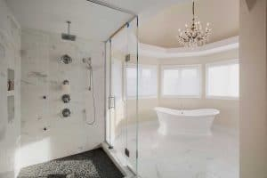 A large contemporary master bathroom with various neutral shades of white and beige