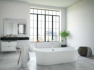 Bathtub in a large modern bathroom interior