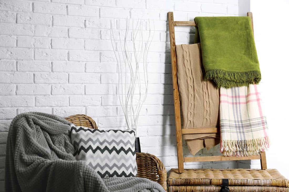 Blanket hanging on a decorative ladder