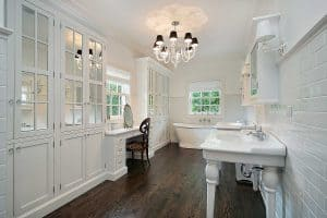 Classic white master bathroom with dark wood floors