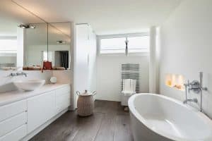 Comfortable bathroom in modern design with wooden floor