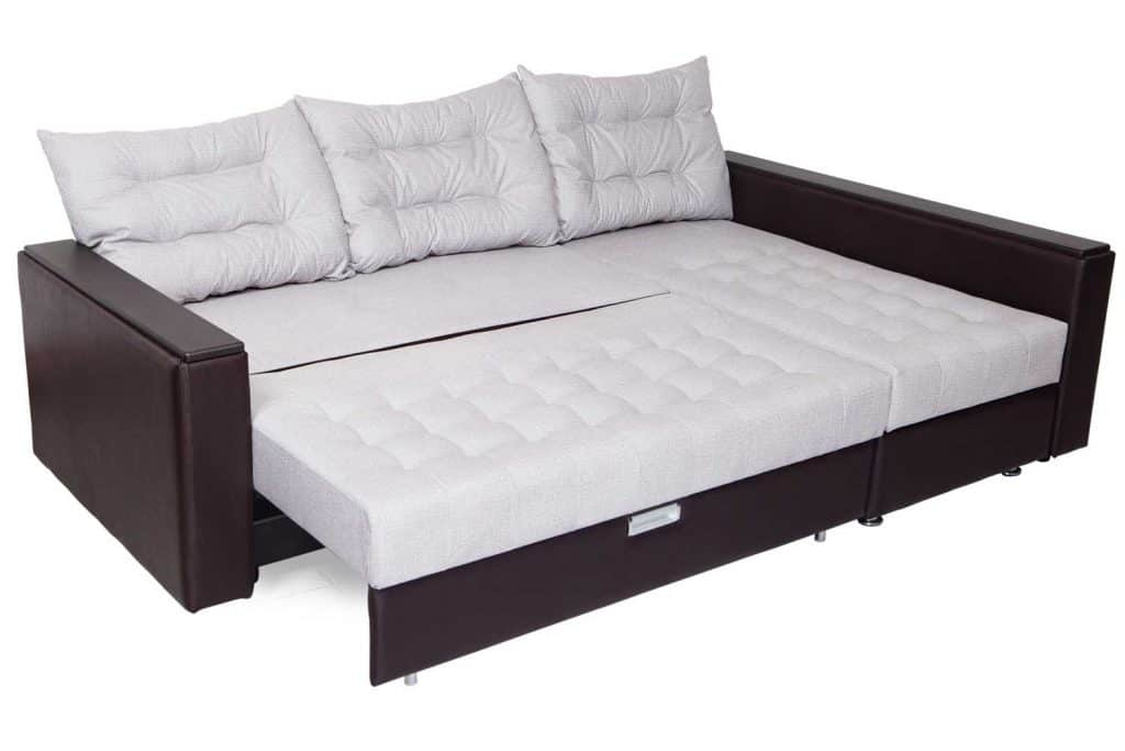 Folding sofa bed of white, full-size, armrests upholstered brown leatherette