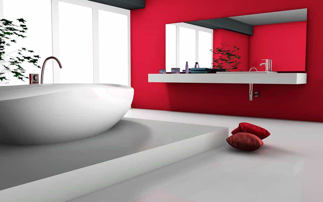 House interior of a modern red bathroom with bathtub in contemporary design