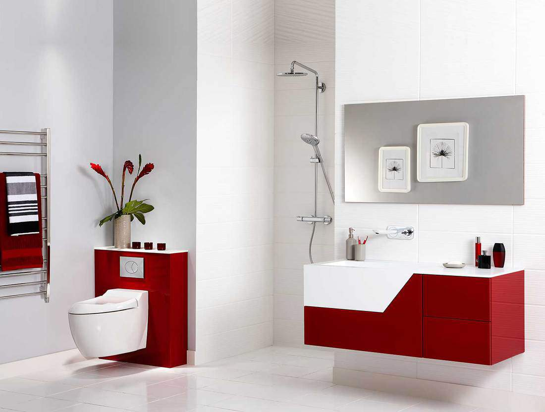 Interior of a spacious bathroom with toilet, shower and washbasin