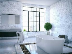 Loft bathroom interior with brick walls