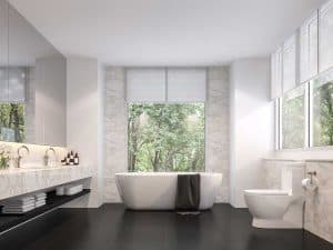 Luxurious bathroom with nature view, black tile floors and white marble walls