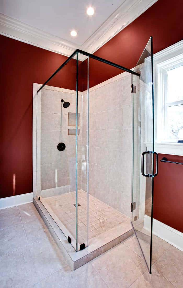 Luxury shower with marble walls and floor and glass front