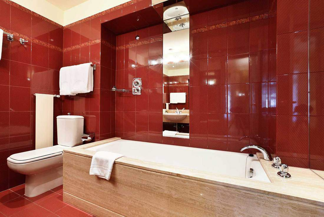 Modern apartment bathroom interior with red tiles