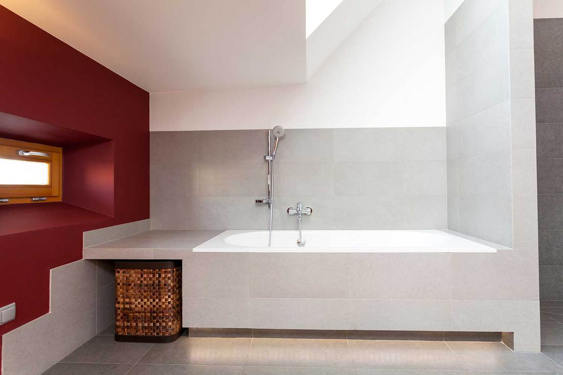 Modern attic bathroom with white and red color concept
