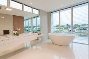 Light-colored bathroom in luxury Australian house with outside view