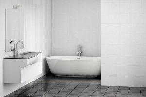 Modern bathroom interior with bathtub, sink and grey marble tiles