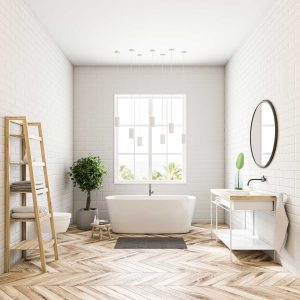 Contemporary bathroom with white walls, a wooden floor, a bathtub standing under the window, and shelves