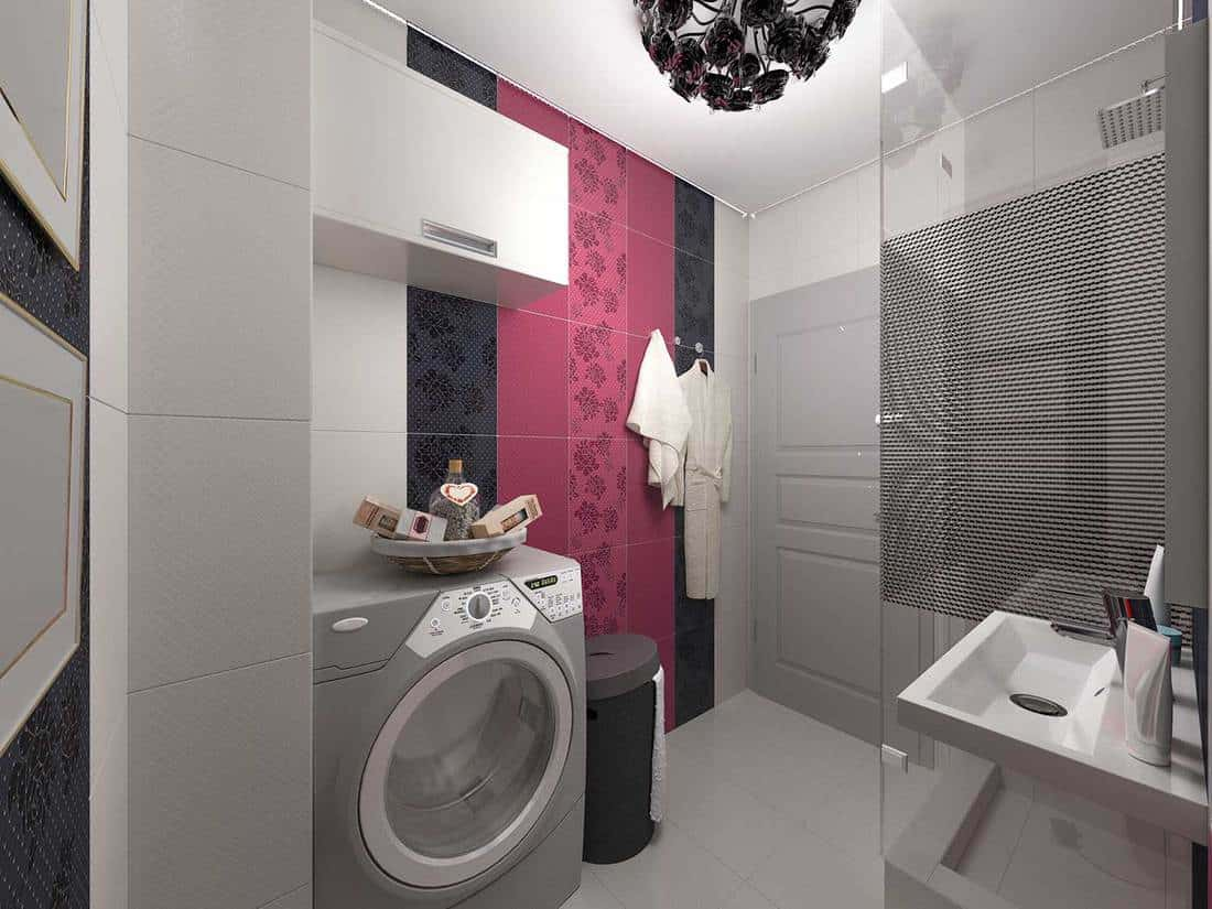 Modern bathroom with laundry in a black, grey and red concept with black rose chandelier