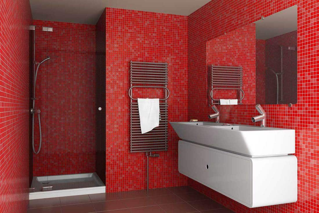 Modern bathroom with red mosaic tiles on wall