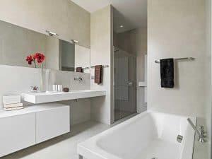 Modern bathroom with shower, washbasin and bathtub