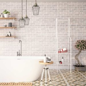 White industrial bathroom interior with brick wall