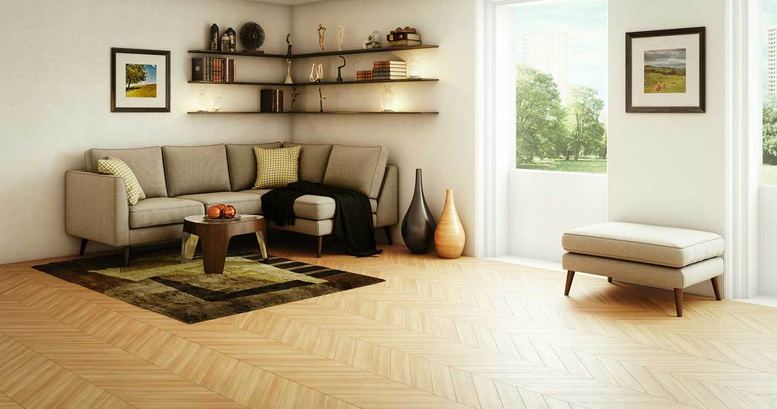 Modern living room interior design with parquet flooring, grey corner sofa and outside view window