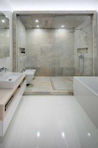 Loft style bathroom with sink, toilet, bidet, shower