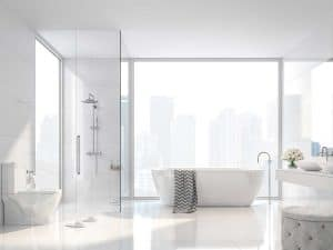 A blank canvass type bathroom with large city view windows, white tile wall and floor