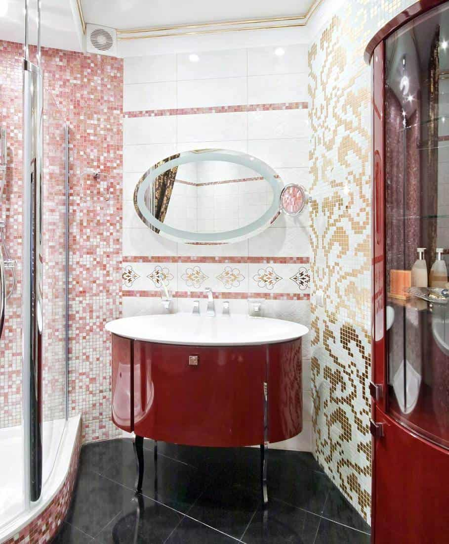 New luxury bathroom with gold and red mosaic tile wall design