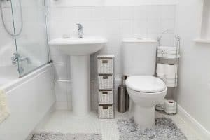 Small modern white bathroom with toiletries