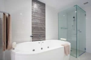 Stylish clean bathroom with shower and bath tub