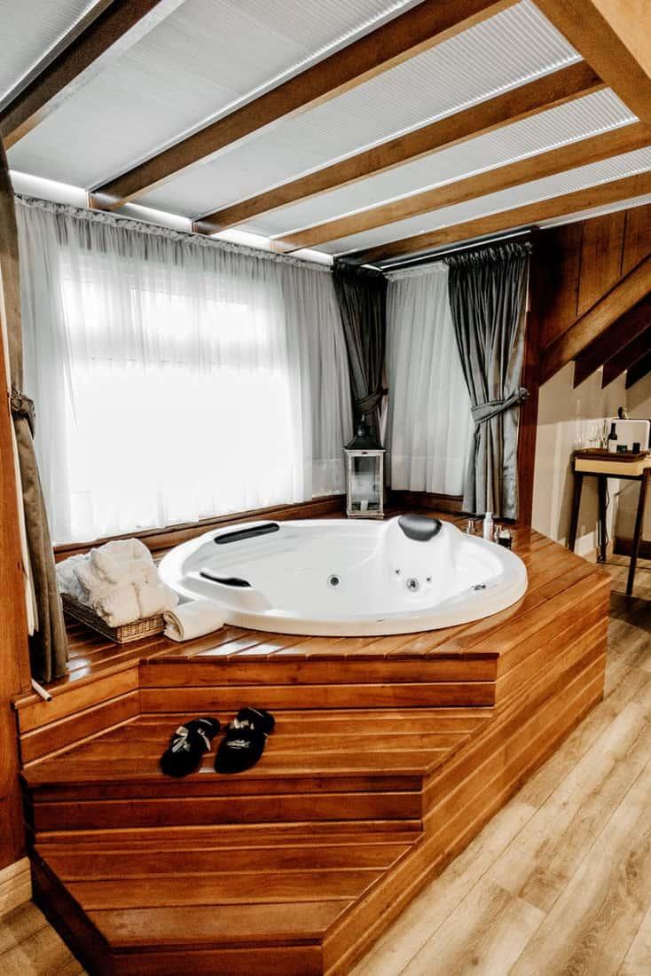 brown wooden framed white tub