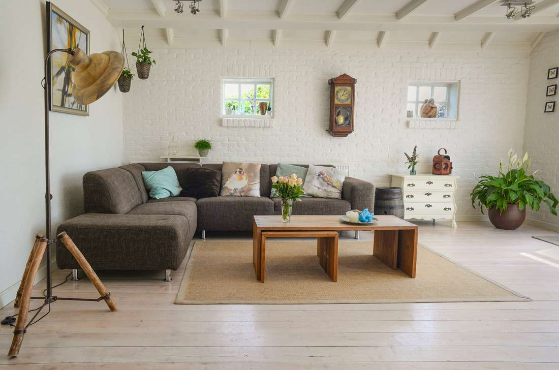 Living room interior with brown sofa bed and lovely throw pillows