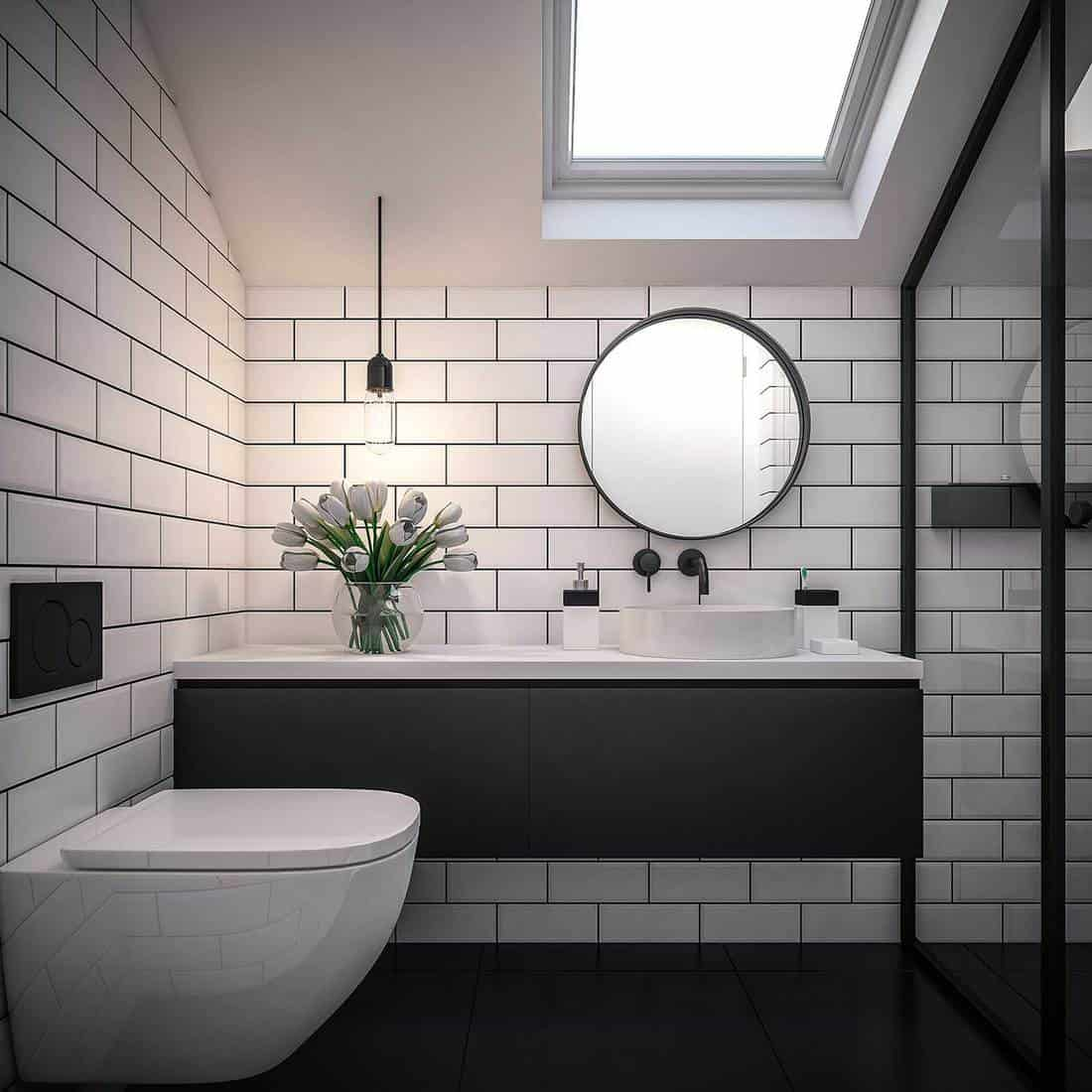 Attic bathroom interior with shower, sink, toilet and brick walls