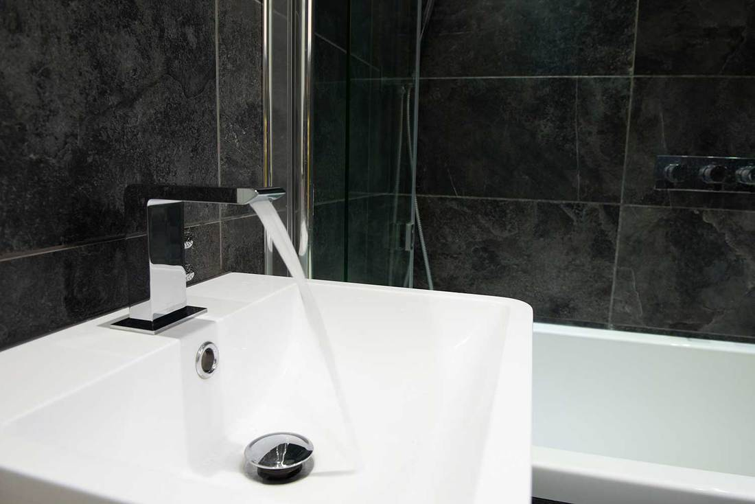 Bathroom tap with running water