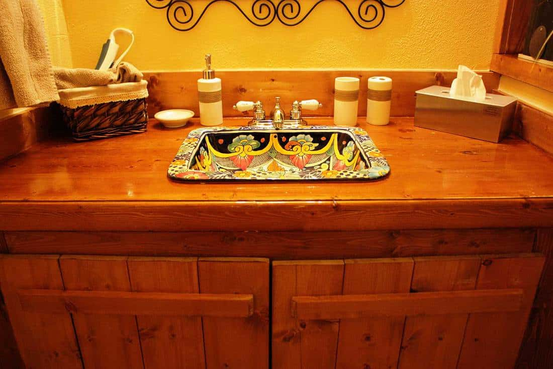 Bathroom with artistic and colorful wash basin